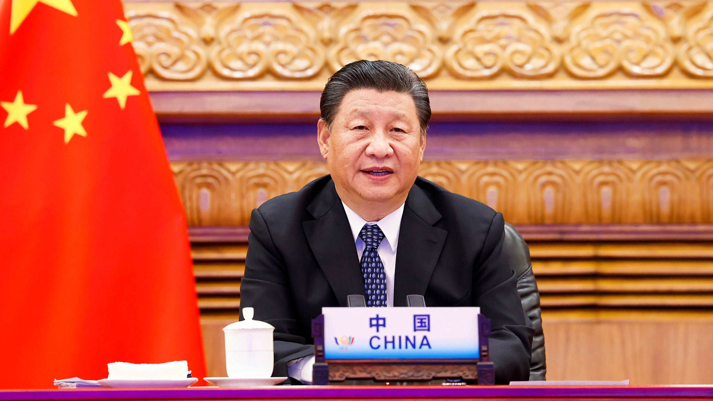 Chinese President says reunification with Taiwan must be achieved, rejects external interference