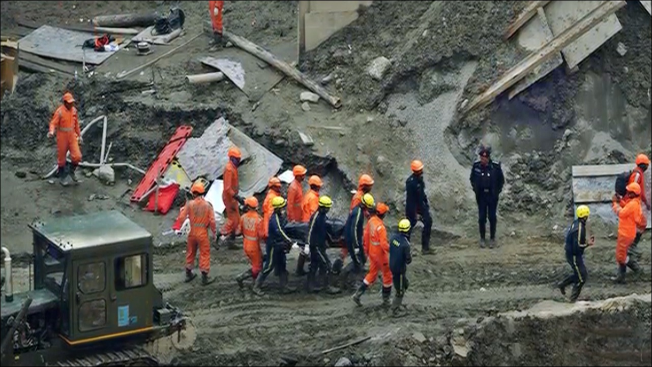 14 workers trapped in a flooded under construction tunnel in South China's Guangdong