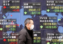 Asian stocks up as Biden signs stimulus, lower yields boost tech