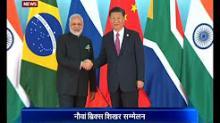 President Xi Jinping welcomes PM Modi at BRICS Summit
