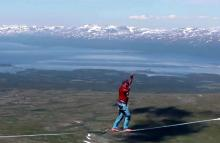 World record as tightrope walkers cross Swedish Arctic valley 600m up